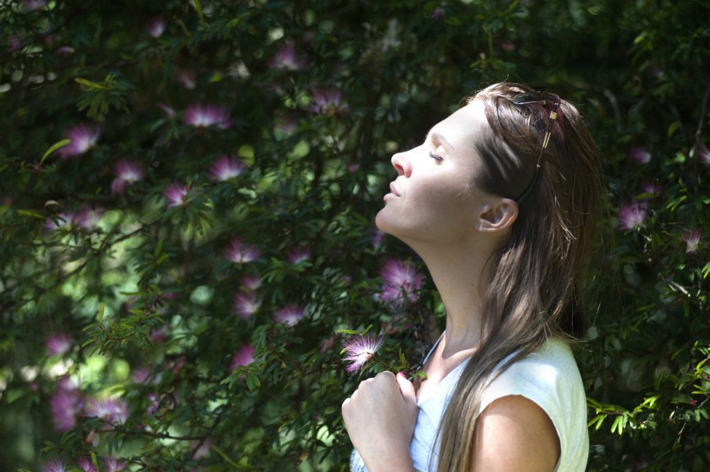 woman smelling air