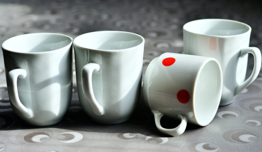 porcelain cups one tipped over