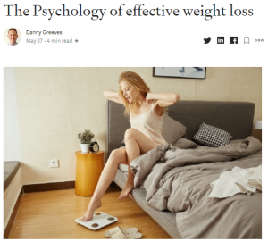article woman on scales in bed